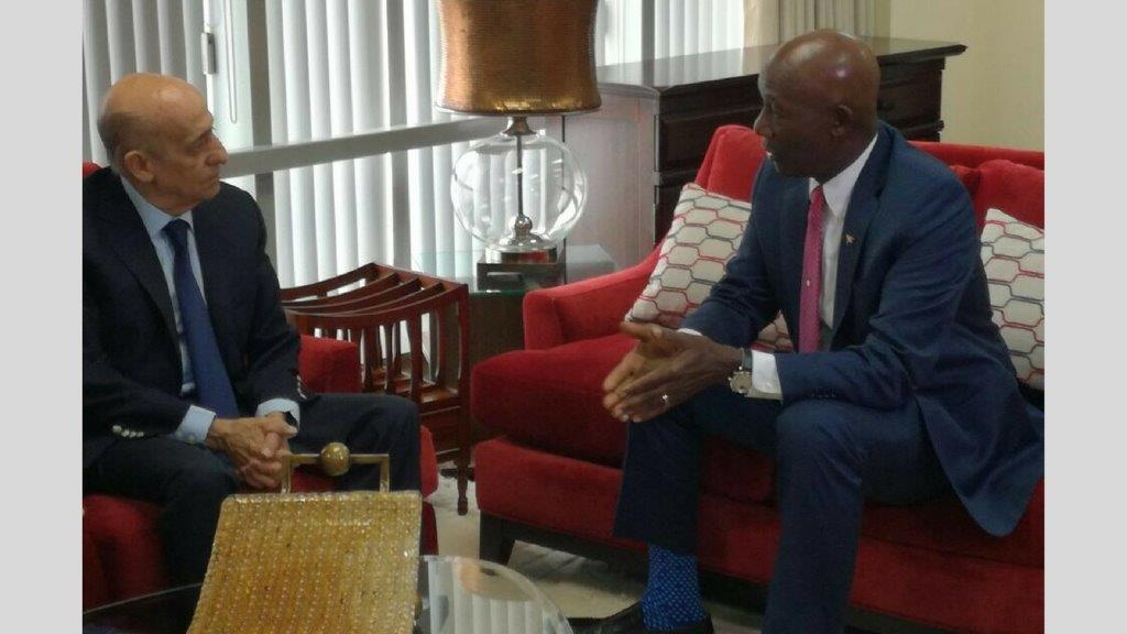 Prime Minister, Dr Keith Rowley chats with Julio Maglione, President of FINA