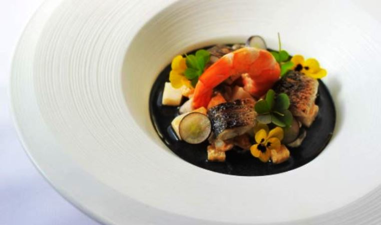 A Chef Jason Howard dish - Seafood chowder with squid ink, mussels and cockles; eddoe, sweet potato, roasted mackerel and scotch oil with herbs. (PHOTO: Instagram/@dine_chefjasonhoward)