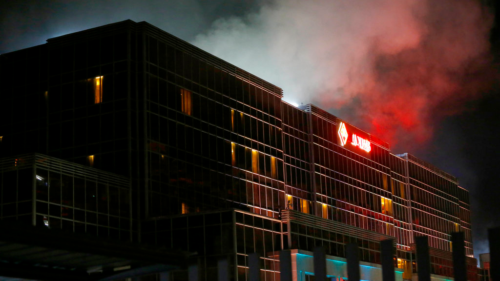 Smoke rises from the Resorts World Manila complex early Friday, June 2, 2017 in suburban Pasay city southeast of Manila, Philippines. Friday, June 2, 2017. (AP Photo/Bullit Marquez)