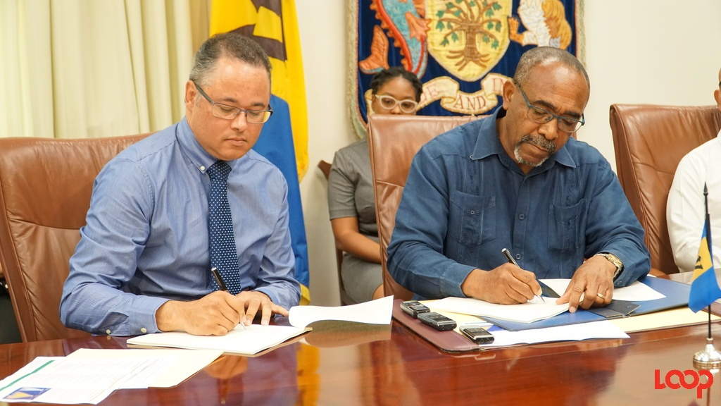Signing were (L-R) Managing Director Barbados Light and Power Ltd. Roger Blackman and Sen The Hon. Darcy Boyce Minister in the Office of the Prime Minister with responsibility for Energy, Telecommunications, Immigration and Invest Barbados. (Photo: Richard Grimes)