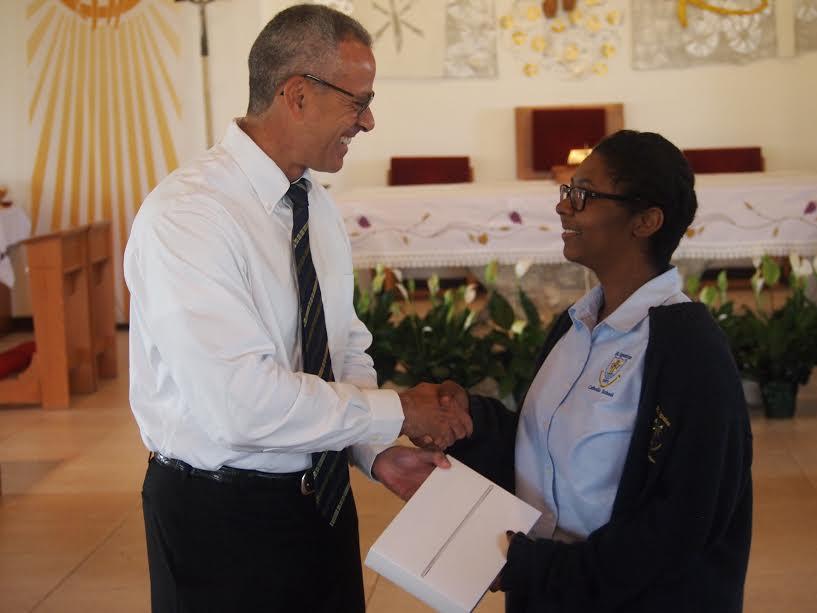 Cayman Finance CEO, Jude Scott, presenting an iPad Air 2 to prize winner Sarah Harrison