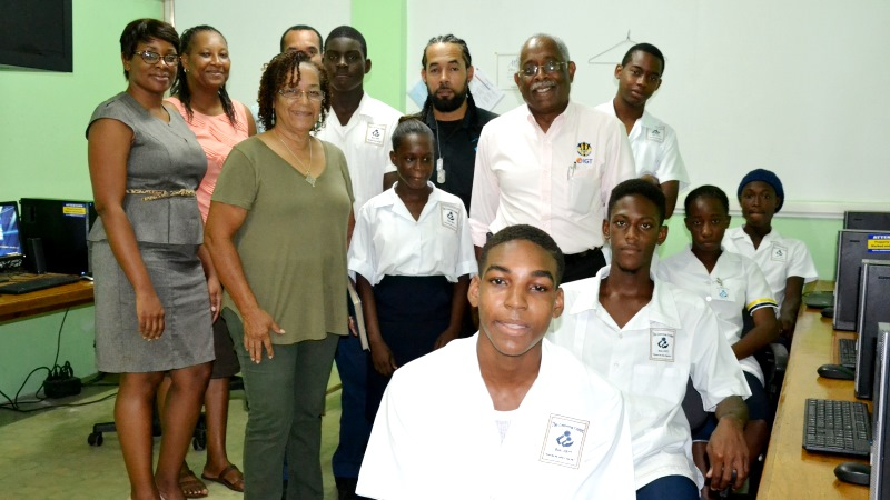 Students from the Barbados Learning Centre join administrators of the institution and representatives from the Barbados Lottery at the recent handover of new equipment for the school's IGT After School Advantage Centre. Adults, pictured from left are: Kerry-Ann Cummins (IGT Barbados); Arlene Arthur (Acting Principal), Dawn Rudder (Retired Principal), Nigel Reece (IGT Barbados –partly hidden) , Daniel Coulthrust (IT Teacher) and Dentonia Brewster (IGT Barbados).