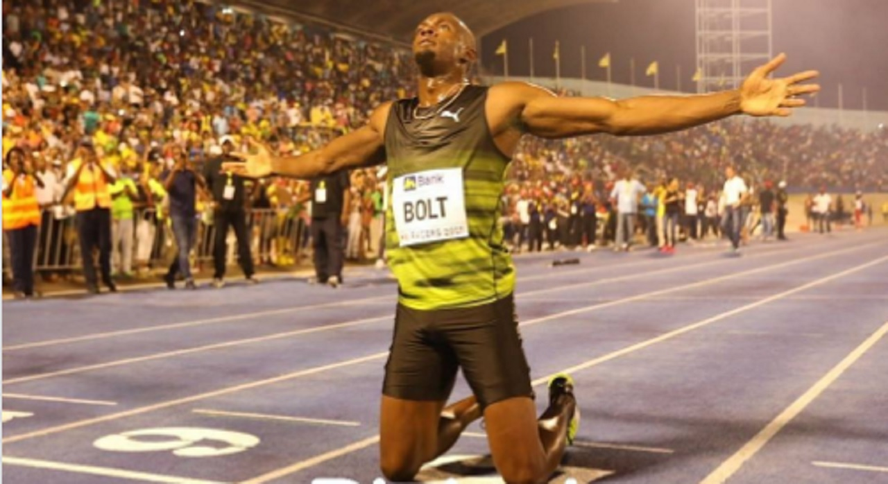 Global sprint sensation Usain Bolt reacts at the finish line after he marked an emotional farewell at a sell-out National Stadium in Jamaica by winning his final race on home soil on Saturday night.