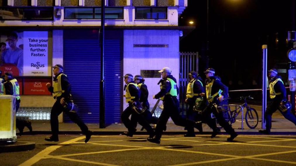 A group of armed British police officers. (AP Photo)