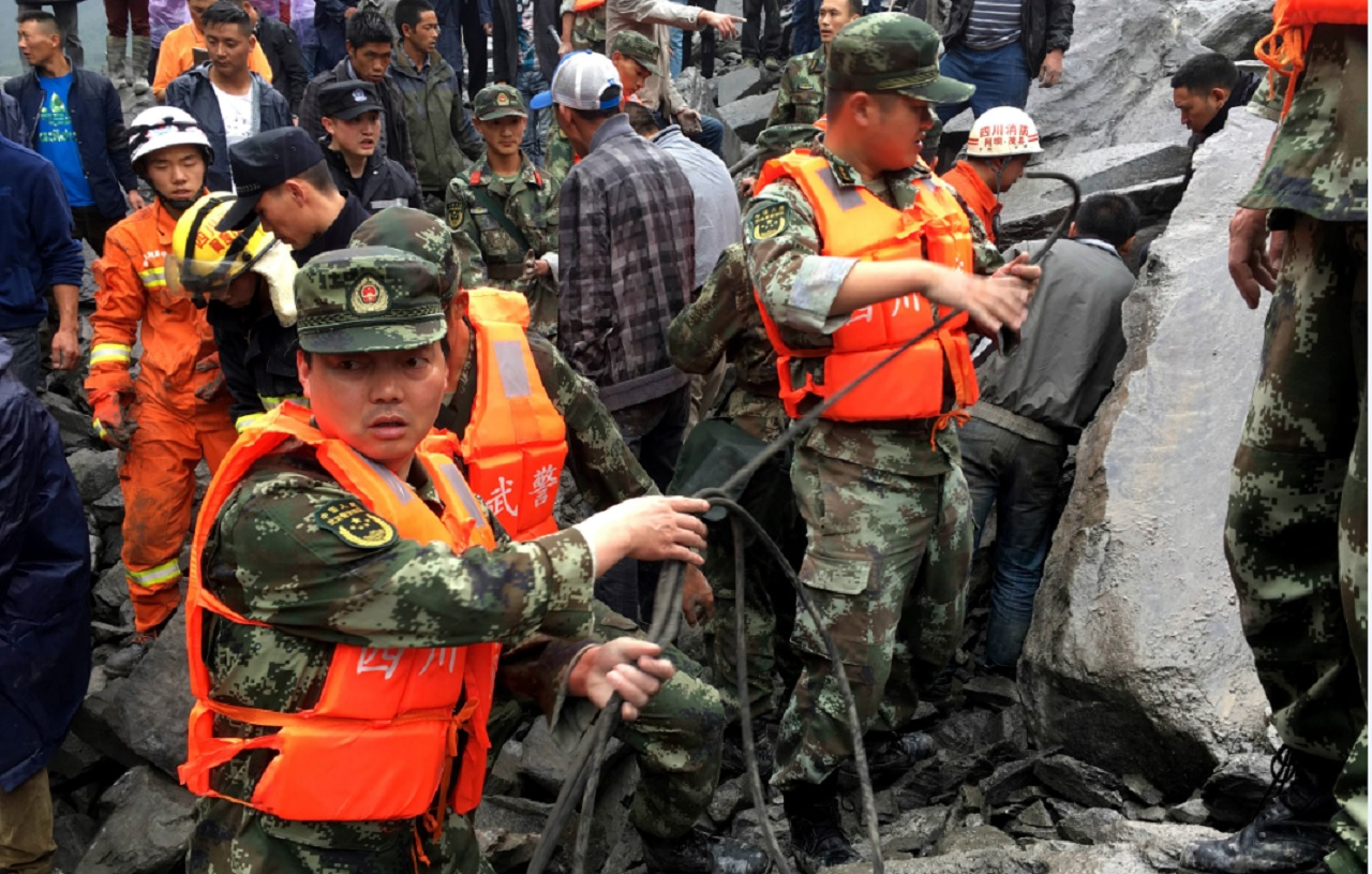Emergency personnel work at the site of a massive landslide in Xinmo village in Maoxian County in southwestern China's Sichuan Province, Saturday, June 24, 2017.