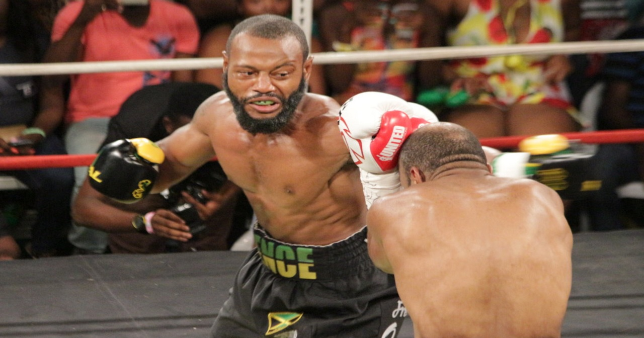 Jamaica's Sakima Mullings (left) attacks Canada's Larone Whyte during their quarter-final bout of the Wray and Nephew Boxing Series on Wednesday night.