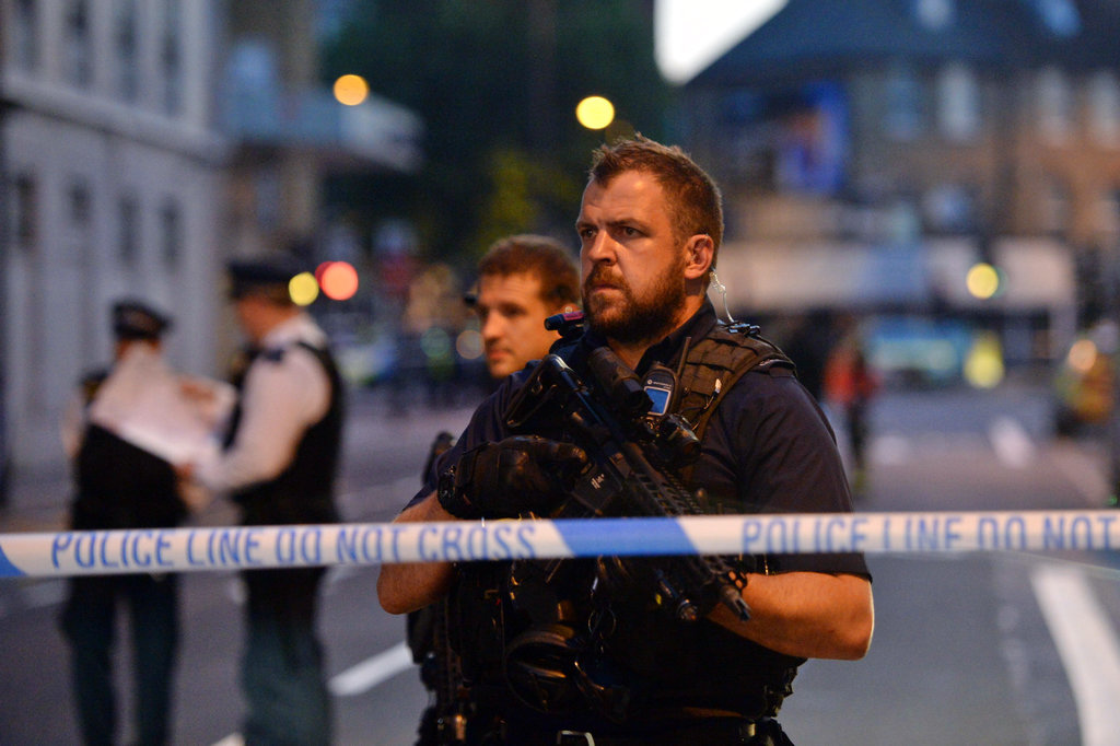 Armed police officers man a cordon in Finsbury Park, north London, where a vehicle struck pedestrians in north London Monday, June 19, 2017. A vehicle struck pedestrians near a mosque in north London early Monday morning. (Victoria Jones/PA via AP)