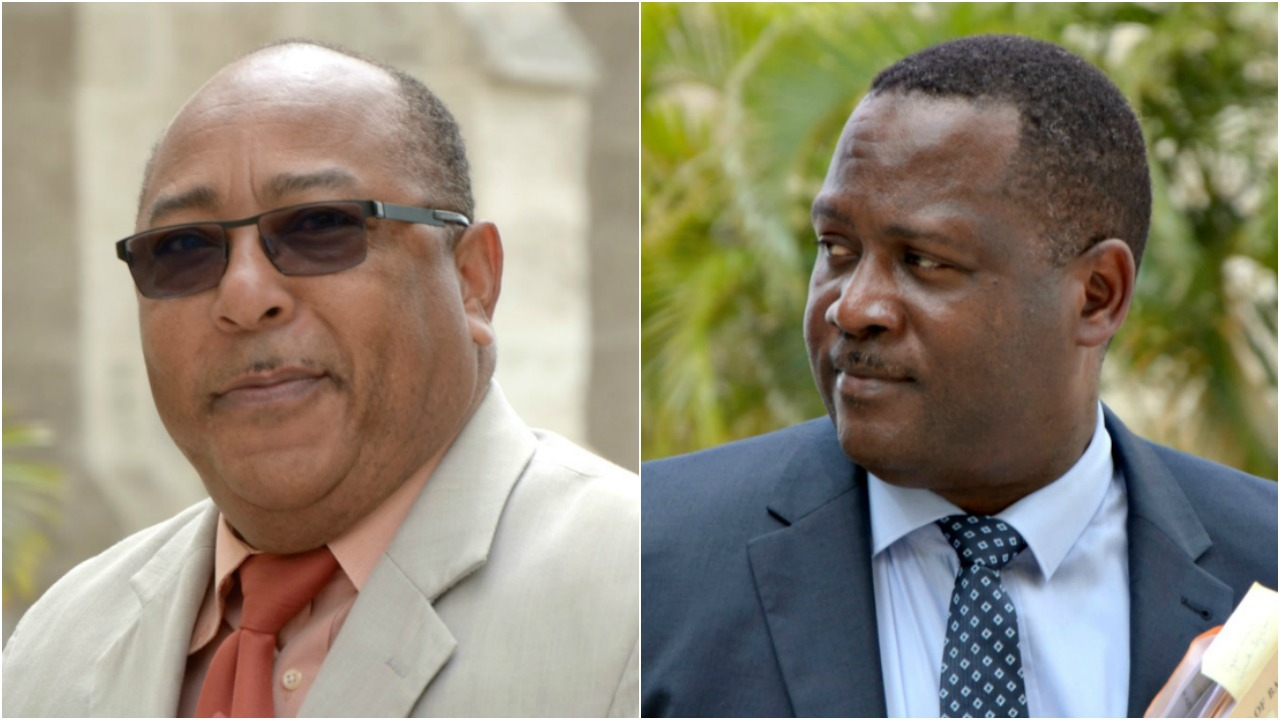 FILE - Cabinet Ministers Dr David Estwick (L) and Donville Inniss.