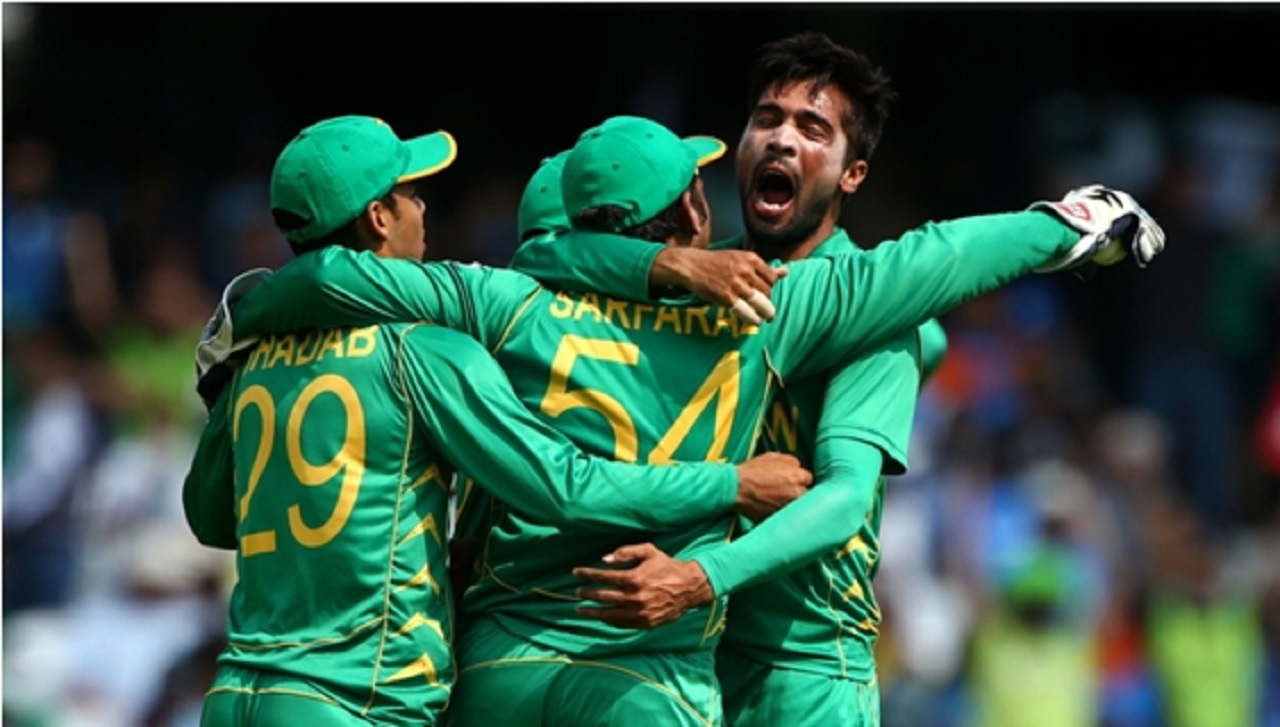 Mohammad Amir celebrates a wicket with his Pakistan team-mates.