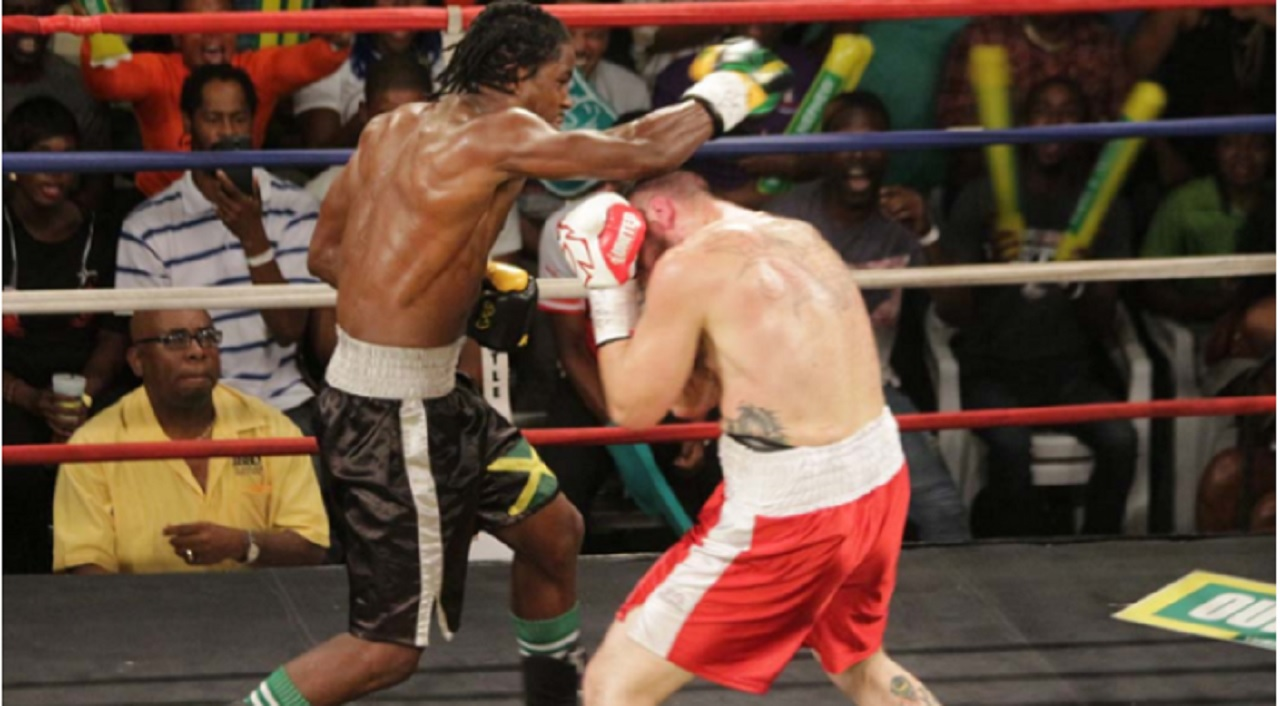 Jamaican Richard 'Frog' Holmes (left) and Mike Breton in action on April 26. Holmes is now in the Contender semis after a unanimous-decision victory on Wednesday night against Canada's Francesco Cotroni.