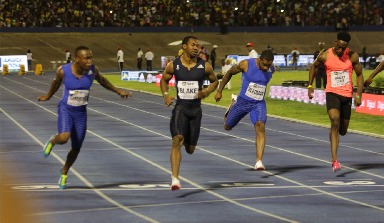 Jamaican sprinter Yohan Blake (centre) wins the Digicel-sponsored men's 100 metres at the JN Racers Grand Prix on Saturday.