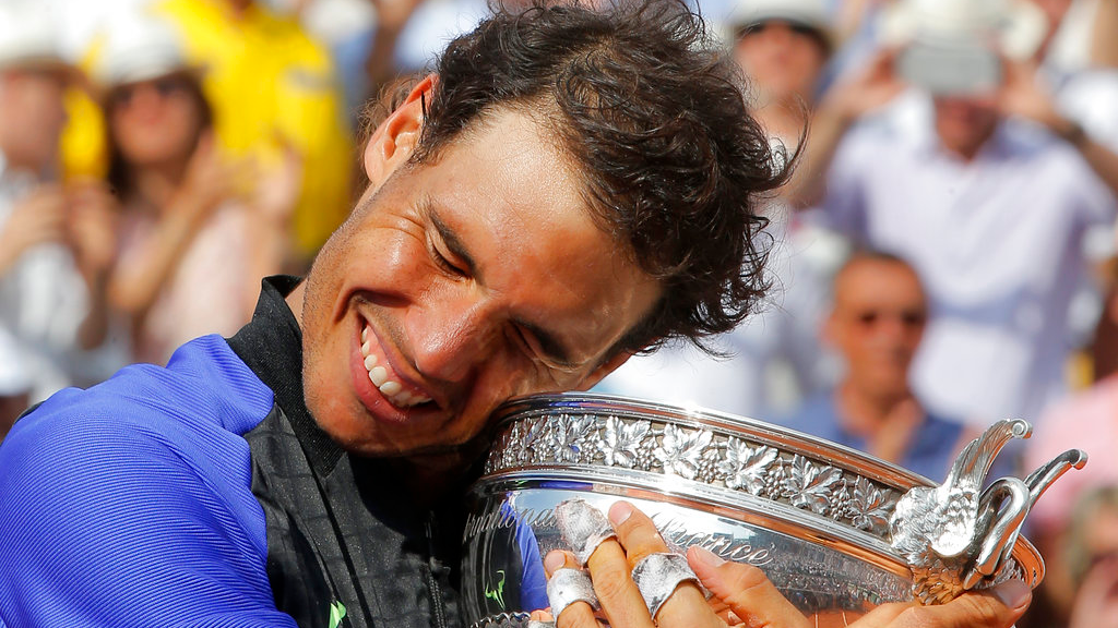Spain's Rafael Nadal holds the cup after defeating Switzerland's Stan Wawrinka in their final match of the French Open tennis tournament at the Roland Garros stadium, Sunday, June 11, 2017 in Paris. (AP Photo/Michel Euler)