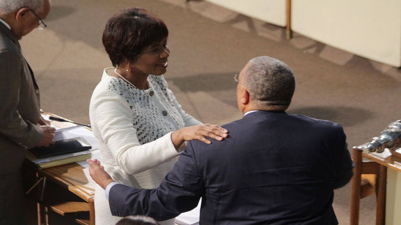 Portia Simpson Miller with Dr Peter Phillips in Parliament on Tuesday.