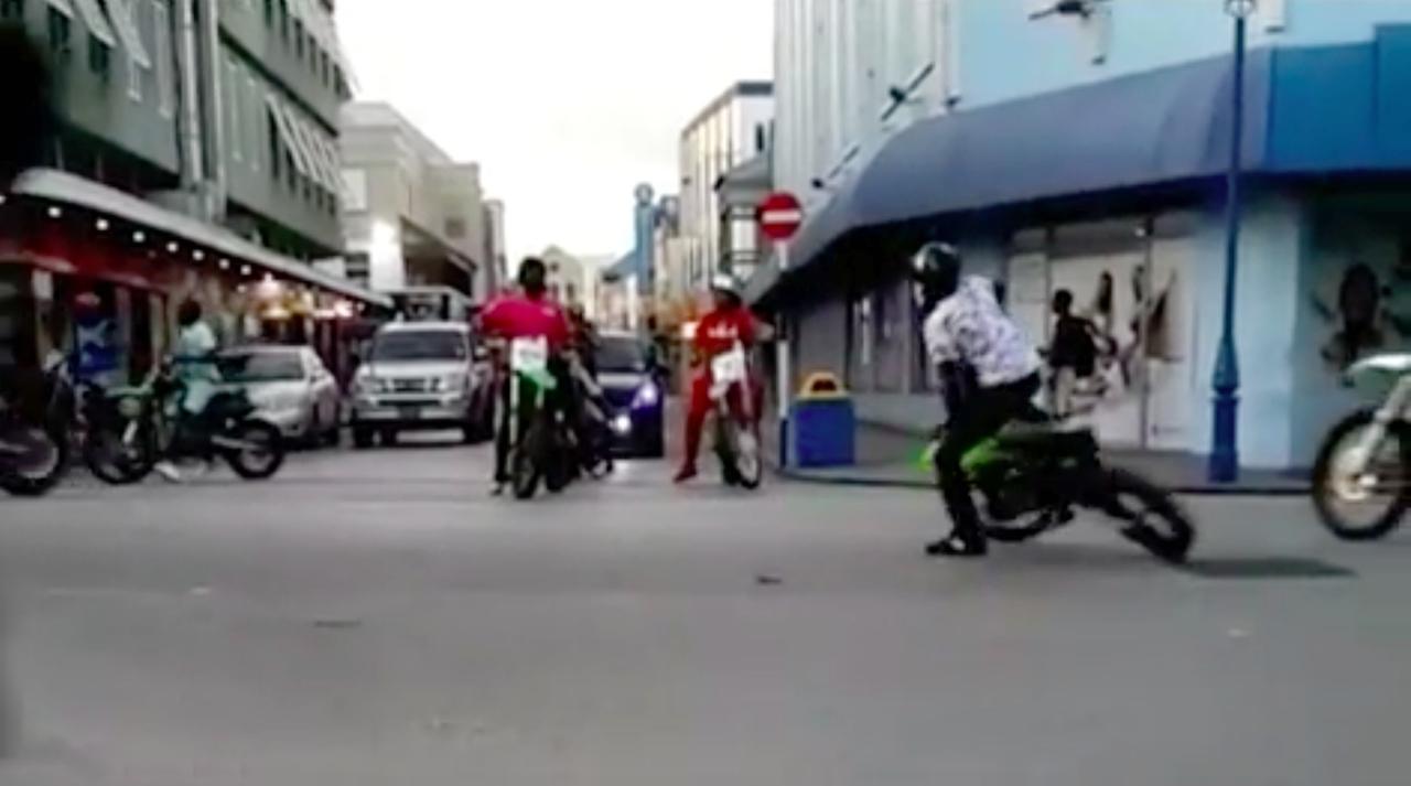 Motocross bikers along Lower Broad Street.