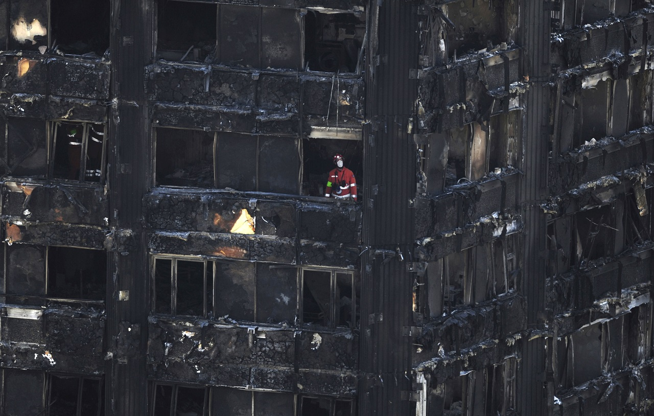 Urban Search and Rescue officers from London Fire Brigade inside the Grenfell Tower in west London after a fire engulfed the 24-storey building on Wednesday morning, Saturday, June 17, 2017. Public fury over the London high-rise fire is mounting as exhausted London firefighters continue their grim search Saturday for victims of the inferno that killed at least 30 people.