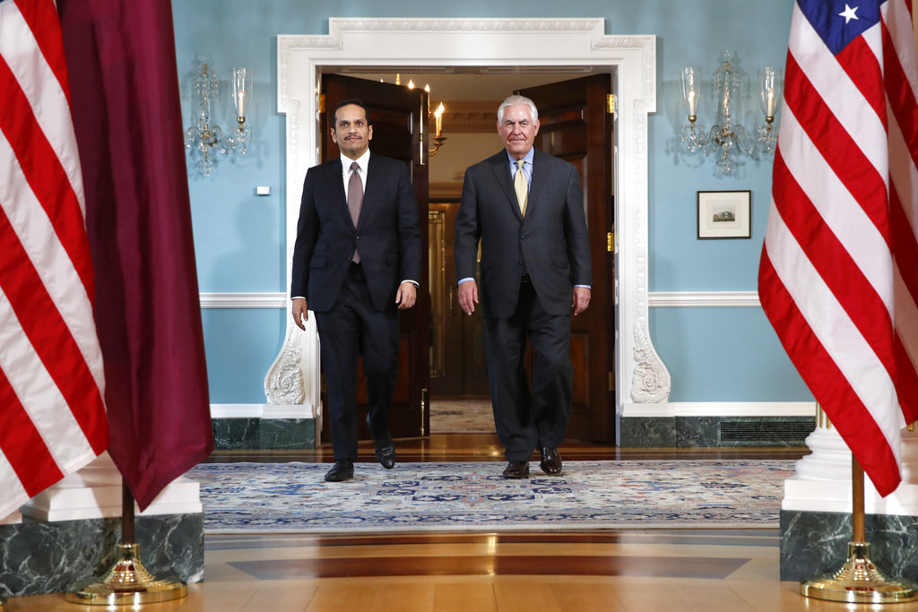In this Monday, May 8, 2017 file photo, Secretary of State Rex Tillerson, right, walks with Qatari Foreign Minister Sheikh Mohammed bin Abdulrahman bin Jassim Al Thani, at the State Department in Washington.  (AP Photo/Jacquelyn Martin, File)
