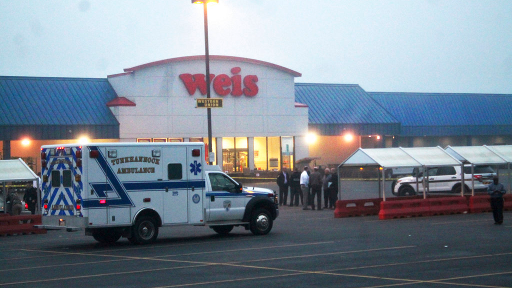 An ambulance waits outside of a Weis Market, the scene of a shooting in Tunkhannock, Pa., on Thursday, June 8, 2017. (Robert Baker/The Times & Tribune via AP)