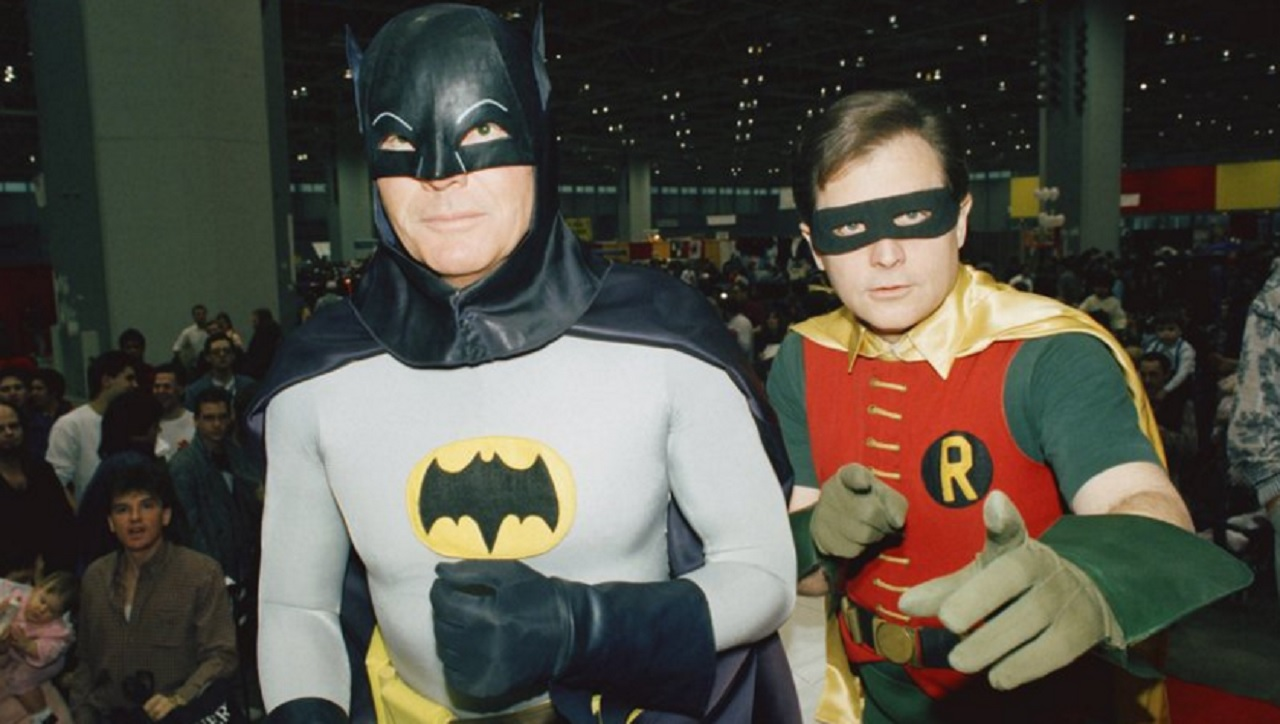 "In this Sunday, Jan. 27, 1989 file photo, actors Adam West, left, and Burt Ward, dressed as their characters Batman and Robin, pose for a photo at the ""World of Wheels"" custom car show in Chicago."