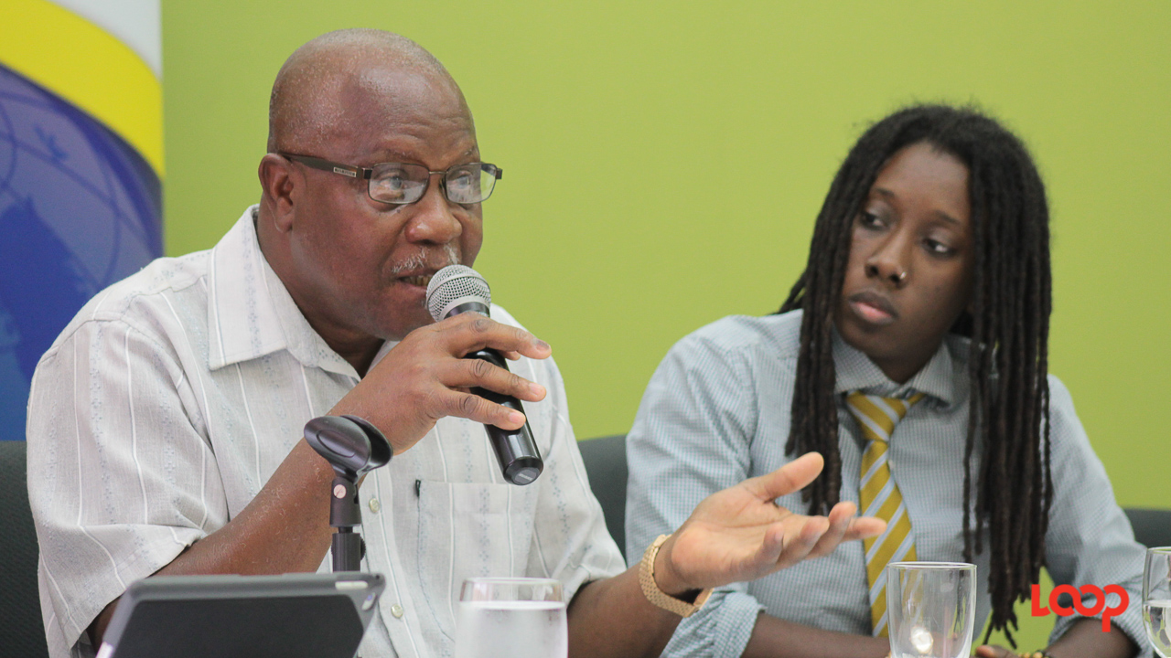 Acting Chief Labour Officer, Victor Felix and human rights activist and founder of B-GLAD, Donnya Piggott during a panel discussion organised by the Human Resources Management Association of Barbados (HRMAB).