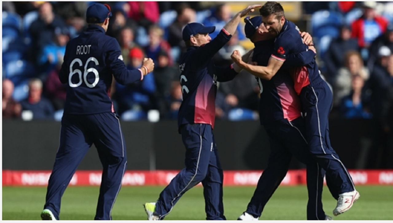 England players celebrate the wicket of New Zealand's batsman Kane Williamson.