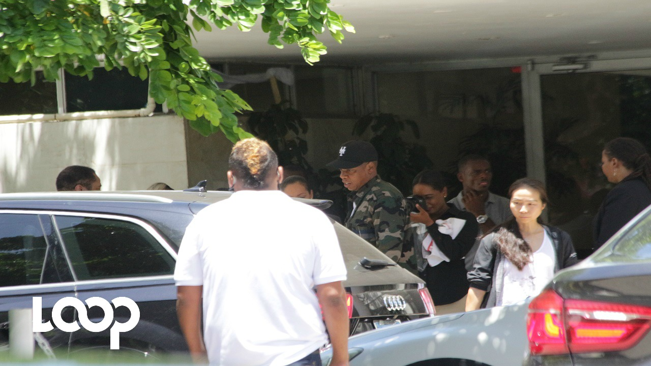 Rap superstar Jay Z leaves the Jamaica Pegasus hotel in Kingston on Friday. (PHOTO: Marlon Reid)
