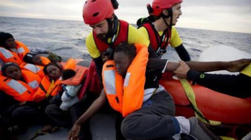 File photos of migrants seeking refuge.