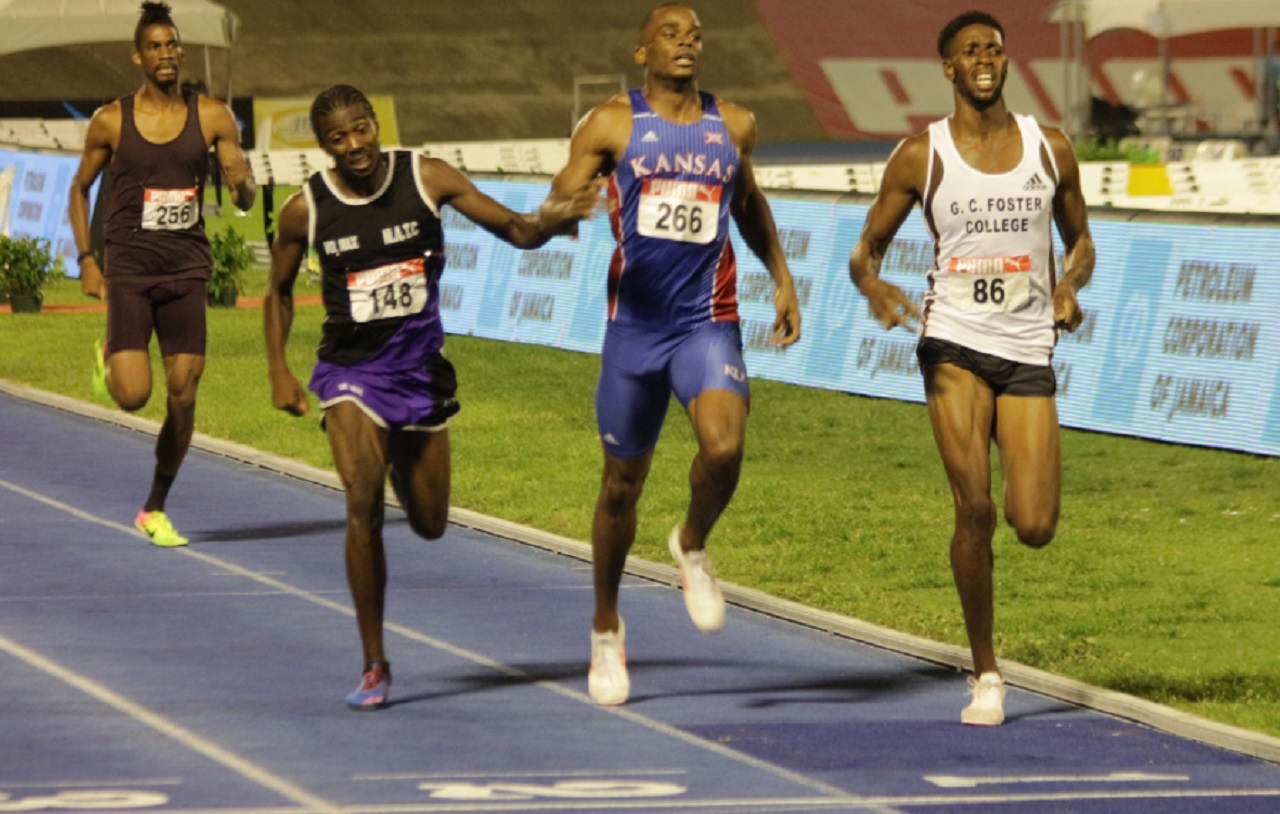 Daniel Glave (right) of GC Foster College wins the men's 800 metres final on Saturday's third day of the National Senior Championships at the National Stadium. Glave won in a time of 1:47.47.