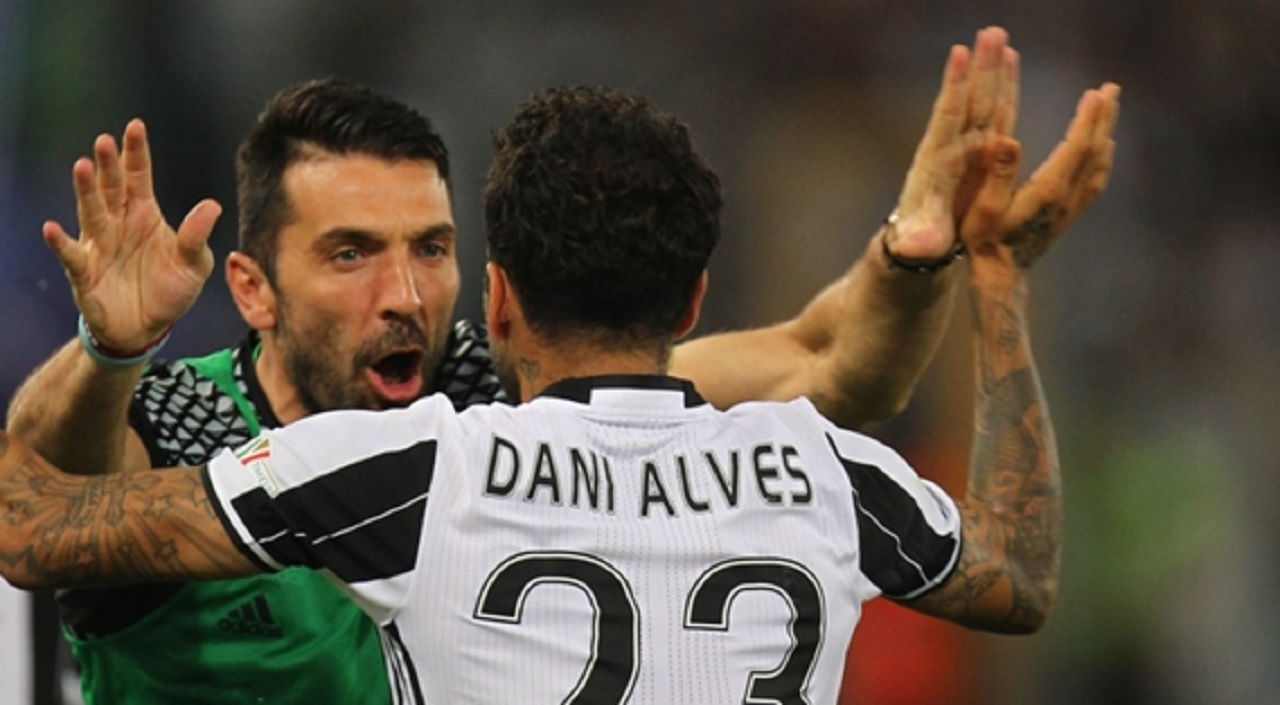 Gianluigi Buffon and captain Dani Alves of Juventus.