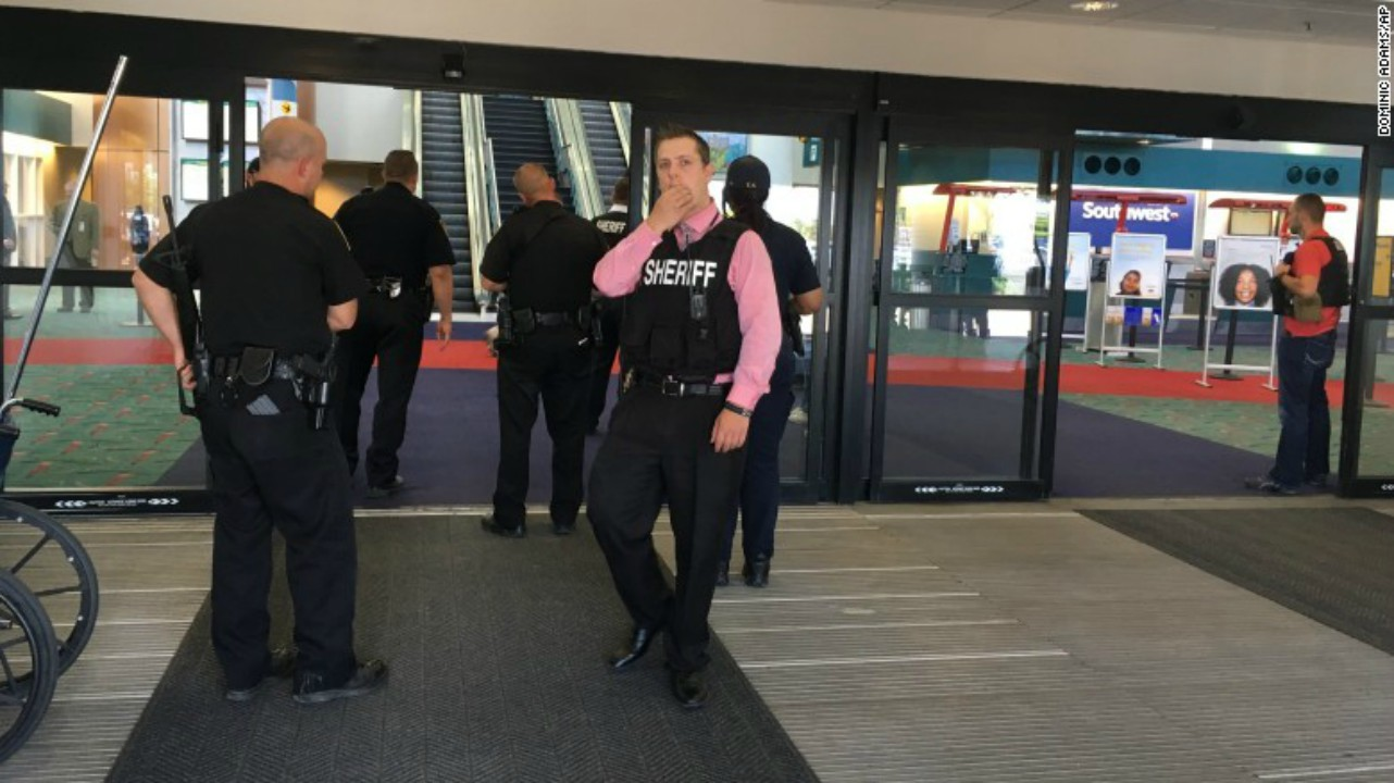 Police officers at the terminal at Bishop International Airport. (CNN.com)