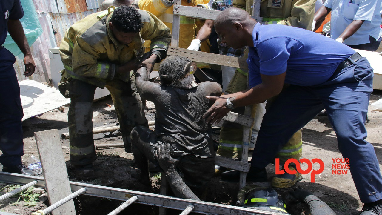Firefighters, with the help of the police and residents, spent over two hours trying to remove the woman, after a section of the pit caved in.