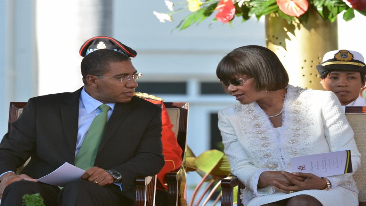 Prime Minister Andrew Holness with former prime minister Portia Simpson Miller at his swearing-in ceremony.
