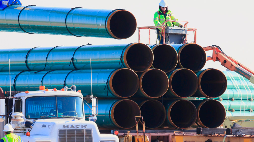 In this May 9, 2015, file photo, workers unload pipes in Worthing, S.D., for the Dakota Access oil pipeline that stretches from the Bakken oil fields in North Dakota to Illinois.