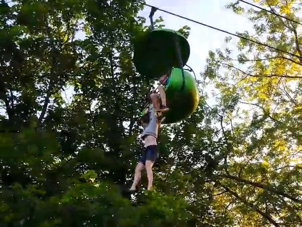 The 14-year-old dangles from a stopped Sky Ride at Six Flags Great Escape in upstate Queensbury, N.Y., on Saturday. (NYDailyNews.com/LOREN LENT VIA FACEBOOK)
