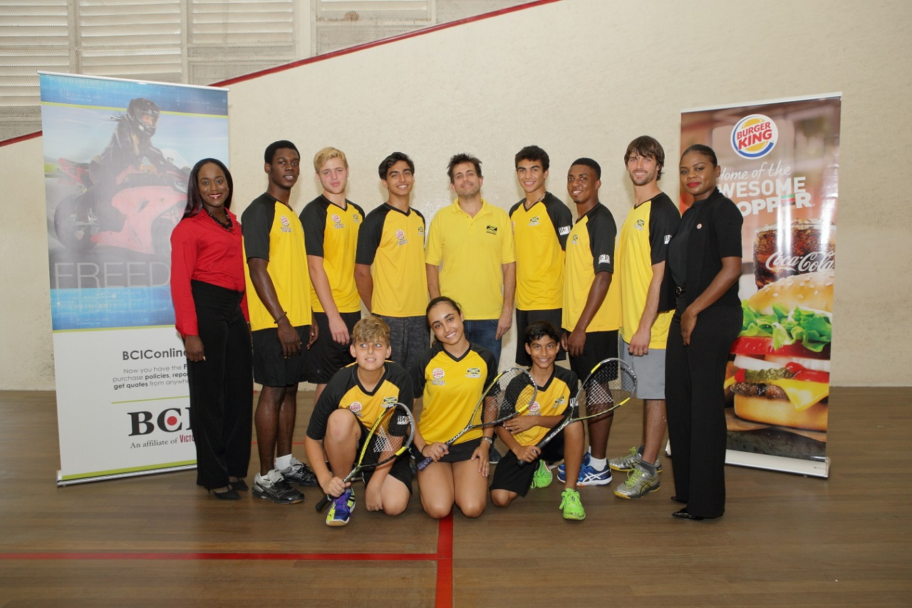 Members of Jamaica's junior national squash team pose with Burger King Brand Manager, Karma-Gaye Williams, (right);  BCIC Marketing Associate, Davee' Williamson, (left) along with coaches, Julian Morrison (second left) and Bruce Levy, (second right) and Vice President of the Jamaica Squash Association, Bruce Levy, (centre).