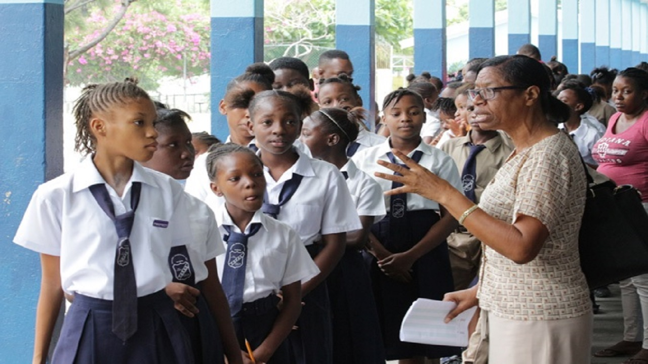 Students of Iris Gelly Primary in Kingston listen attentively to a school administrator ahead of GSAT earlier this year.