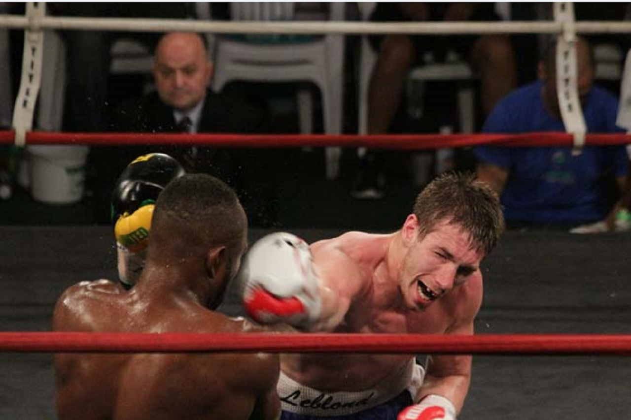 Canadian Dave Leblond (right) in action against Jamaican Tsetsi Davis on April 19 at the Chinese Benevolent Association. Davis was declared the winner on a split decision.
