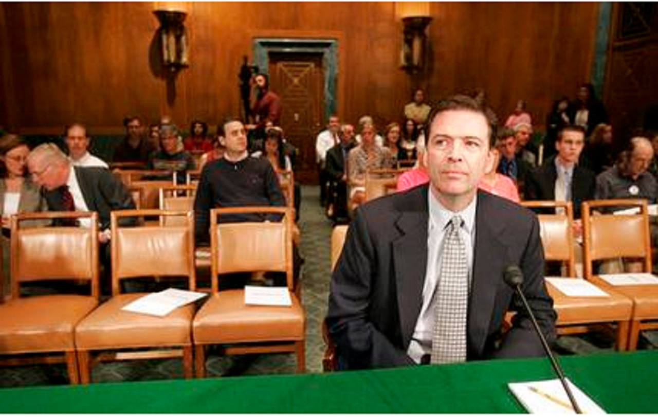 In this May 15, 2007, file photo, then-former Deputy Attorney General James Comey waits to testify on Capitol Hill in Washington, before the Senate Judiciary Committee hearing regarding the fired prosecutors.