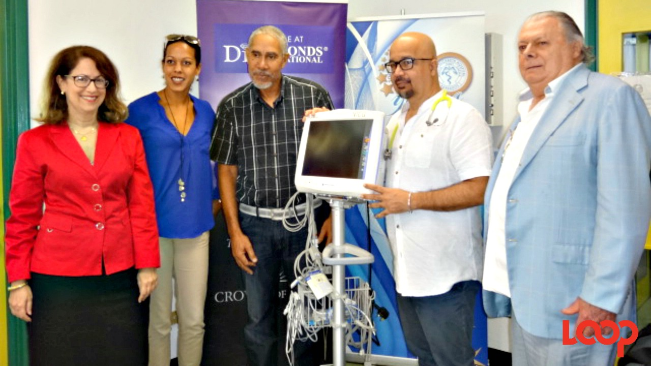 Dr. Clyde Cave, Consultant Department of Paediatrics (second right) accepts the new monitor on behalf of the QEH. He joined members of the Broadway to Barbados Charitable Trust, including Executive Trustee Robert Bourque (right) and Lisa Cole of Scotiabank (left).