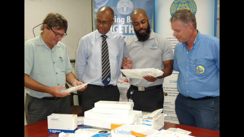John Gill, Head of Department of Surgery and Consultant Neurologist (second left) and colleagues with President of the Rotary Club of Barbados West, Kevin Watson (right) at the handover of medical equipment.
