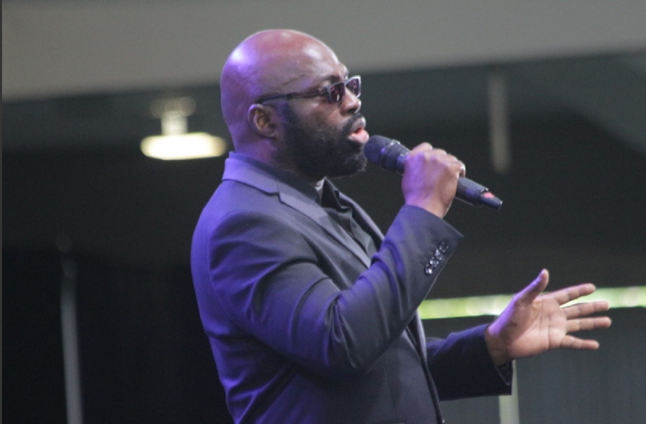 Jamaica's musical maestro Richie Stephens performs at the Thanksgiving Service for the life of the late president of the Jamaica Football Federation, Captain Horace Burrell on Wednesday at the National Arena.