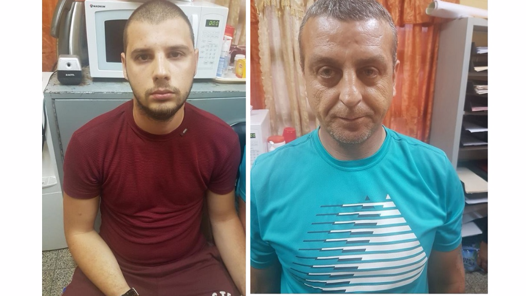 (Photo L-R: Toncho Tonchev and Dimitri Georgiev were caught tampering with an ATM machine in Piarco Plaza.)