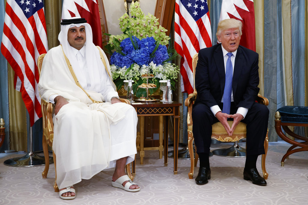 In this May 21, 2017, file photo, President Donald Trump, right, holds a bilateral meeting with Qatar's Emir Sheikh Tamim Bin Hamad Al-Thani, in Riyadh, Saudi Arabia. (AP Photo/Evan Vucci, File)