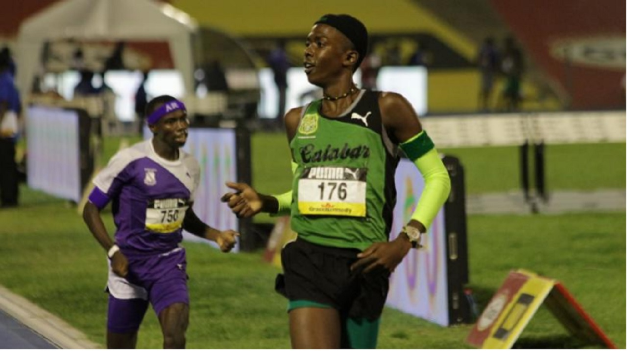A file photo showing Kevroy Venson of Calabar High beating Kingston College's Ugandan runner Arymanya Rodgers in the Class Two Boys' 1500-metre final at this year's ISSA/GraceKennedy Boys and Girls' Athletics Championships at the National Stadium.