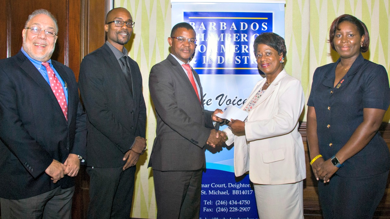 Director, Corporate Banking CIBC FirstCaribbean International Bank, Barrington Watson, third from left, presents a donation to Manager of the St. Michael District Hospital, Joanell Oxley-Worrell. Other members of the presentation party are from left, President of the Barbados Chamber of Commerce and Industry (BCCI), who is also managing director of Abed Enterprises, Eddy Abed; the chamber's Executive Director,  Carlos Wharton, and the hospital's acting Principal Nursing Officer, Francine Watson.