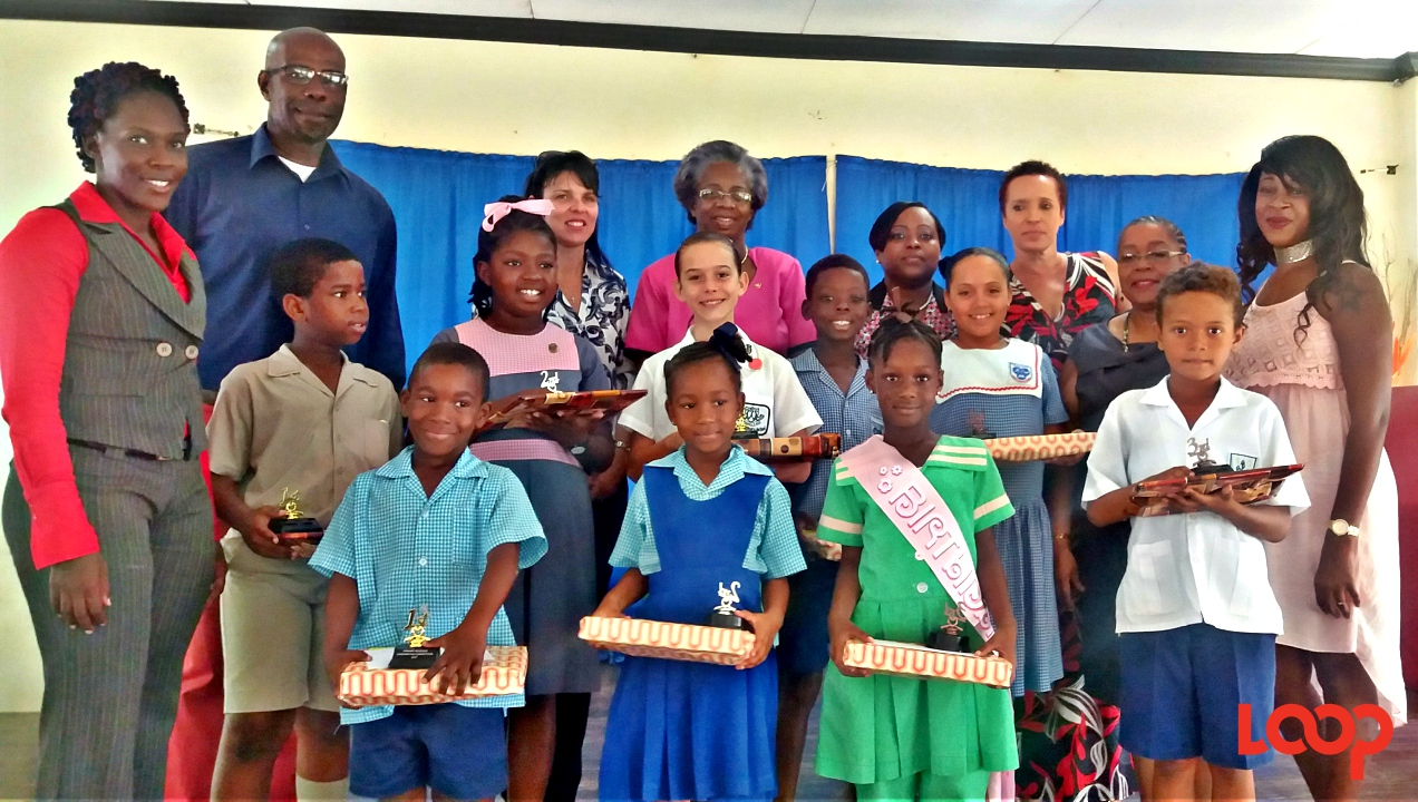 Winners of the Primary Schools Handwriting Competition with teachers and organisers.