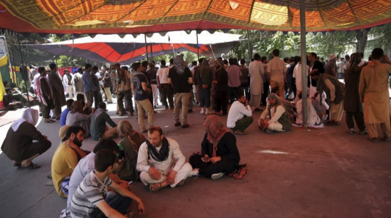 Protesters sit under a tent as the yplan to stay indefinitely near the Wednesday's suicide attack site, in Kabul, Afghanistan, Saturday, Jun 3, 2017. The demonstration in downtown Kabul that left several people dead has entered a second day.