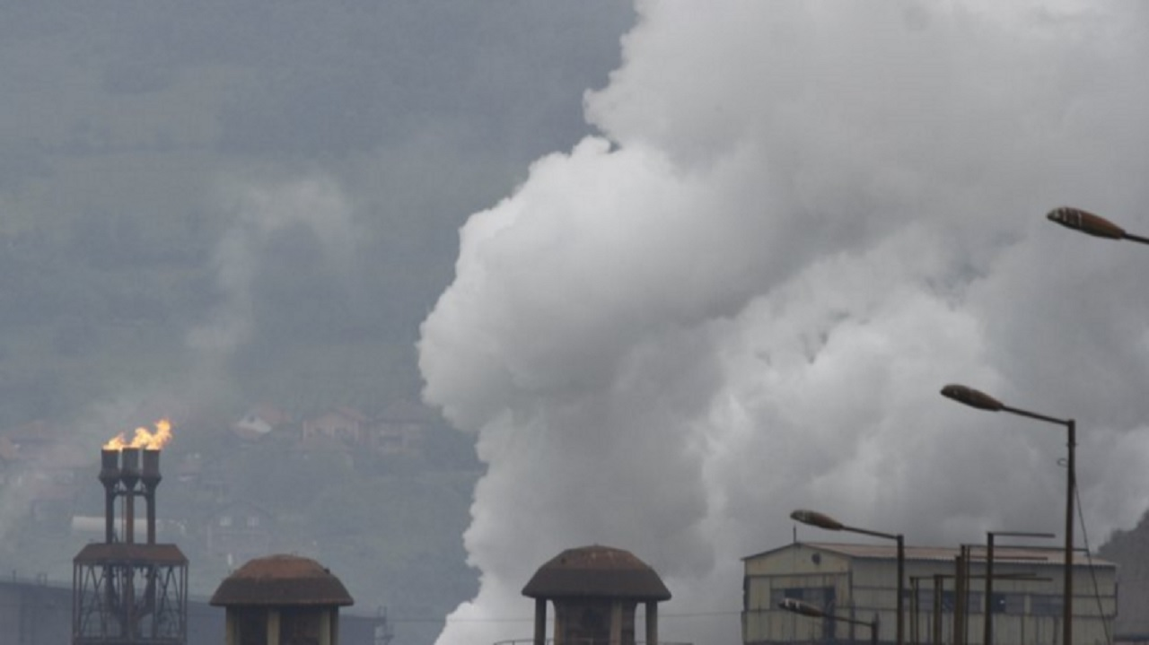 "Smoke from ""Mittal Steel"" factory rising in the air in Bosnian town of Zenica, Bosnia, on Friday, June, 2, 2017. Environmental activists in Bosnia, one of the poorest European countries suffering from some of the world's highest levels of air pollution, are disappointed and concerned over the decision by President Donald Trump to pull the U.S. out of the Paris climate accord."