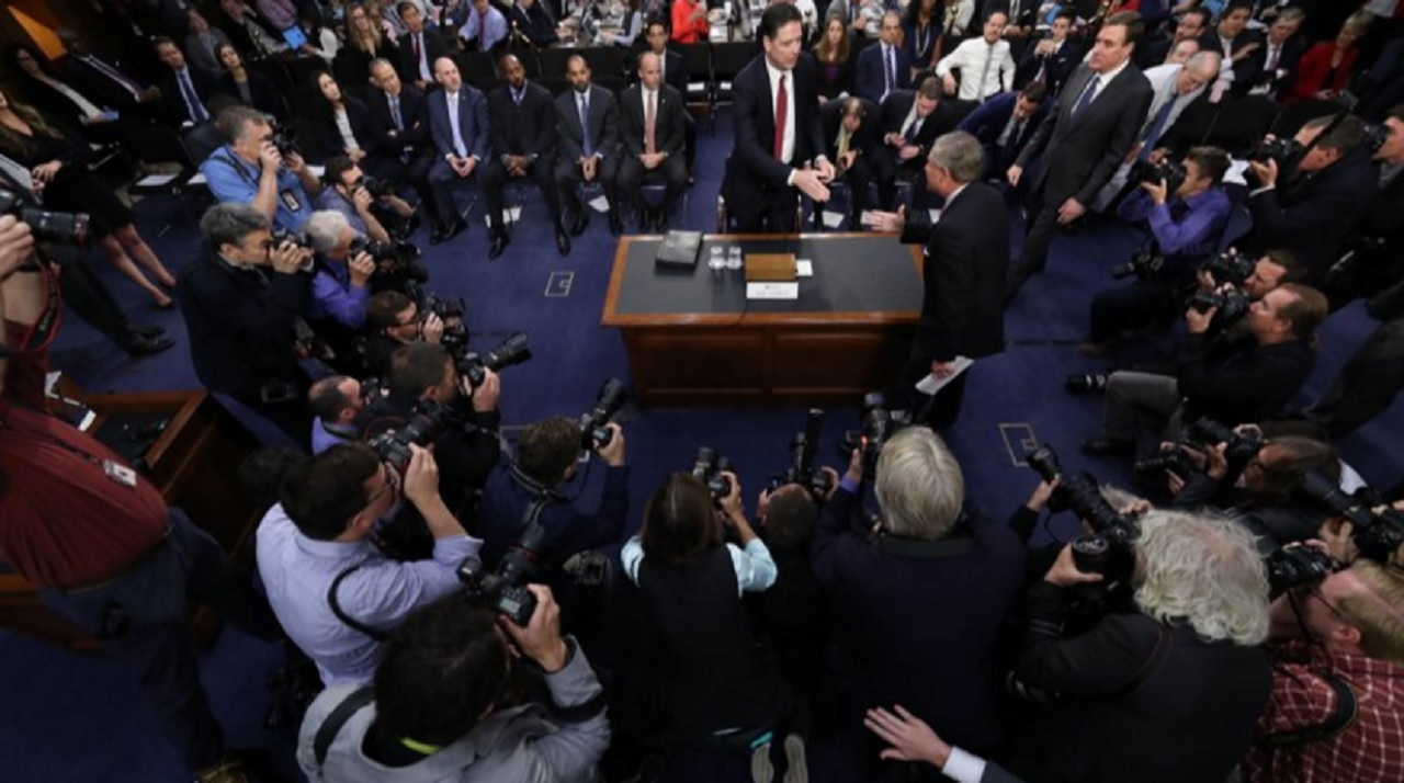 Former FBI director James Comey is greeted by Senate Intelligence Committee Chairman Richard Burr, R-N.C. at the beginning of the Senate Intelligence Committee hearing on Capitol Hill, Thursday, June 8, 2017, in Washington.