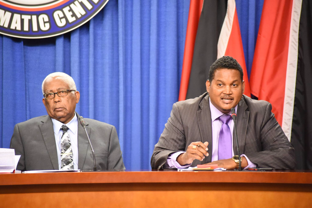 At right, Sport and Youth Affairs Minister Darryl Smith speaks at a Post Cabinet media briefing in April