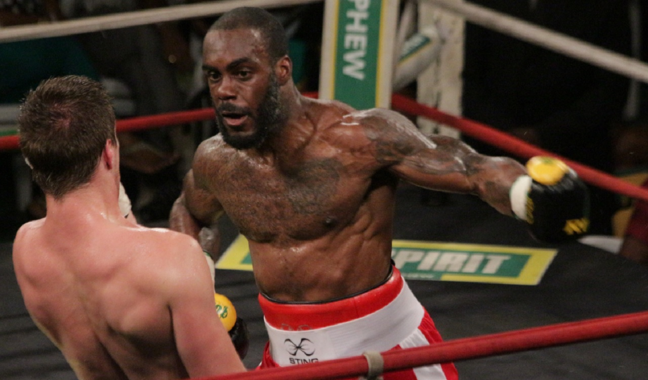 Canadian Phil Rose (left) attacks his countryman Dave Leblond in their quarter-final bout of the Wray and Nephew Junior middleweight Contender Boxing Series on Wednesday night, at the Chinese Benevolent Association.